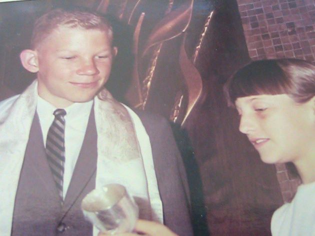 Nancy looks at my kiddush cup after my Bar Mitzvah,  1966.