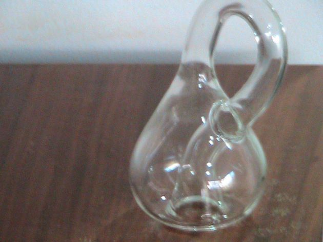 A Kein Bottle, which was given to me by Dad.  A Mobius strip is a two-dimensional surface with one edge.  Technically, a Klein Bottle is a three-dimensional surface with one edge.(It is impossible to realize in practice.)