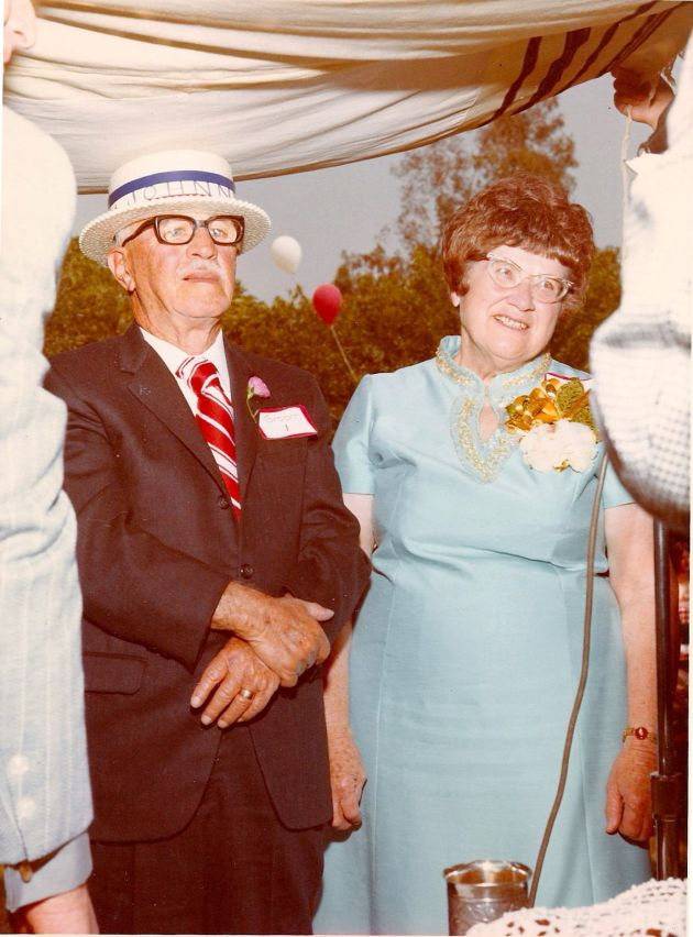 Grandpa Johnny and Grandma Lillian stand under the chupah(the wedding canopy).