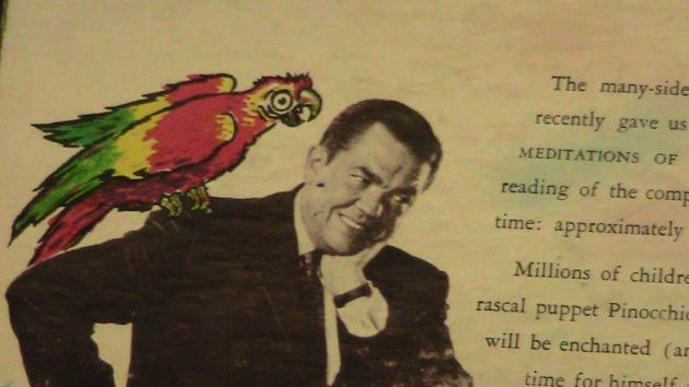 Marvin Miller with a parrot from his recording of Pinocchio